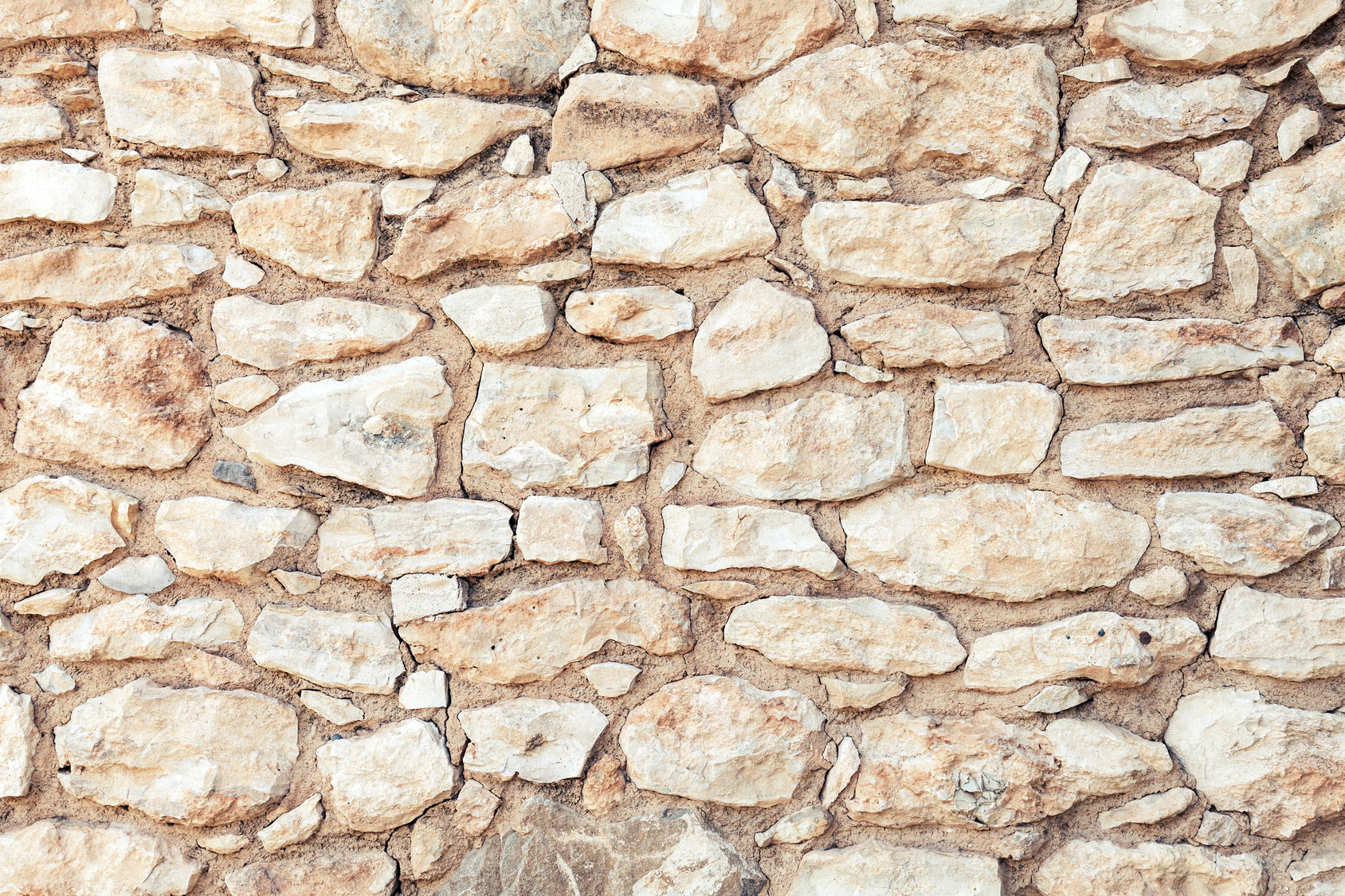 Background photo texture of yellow stone wall